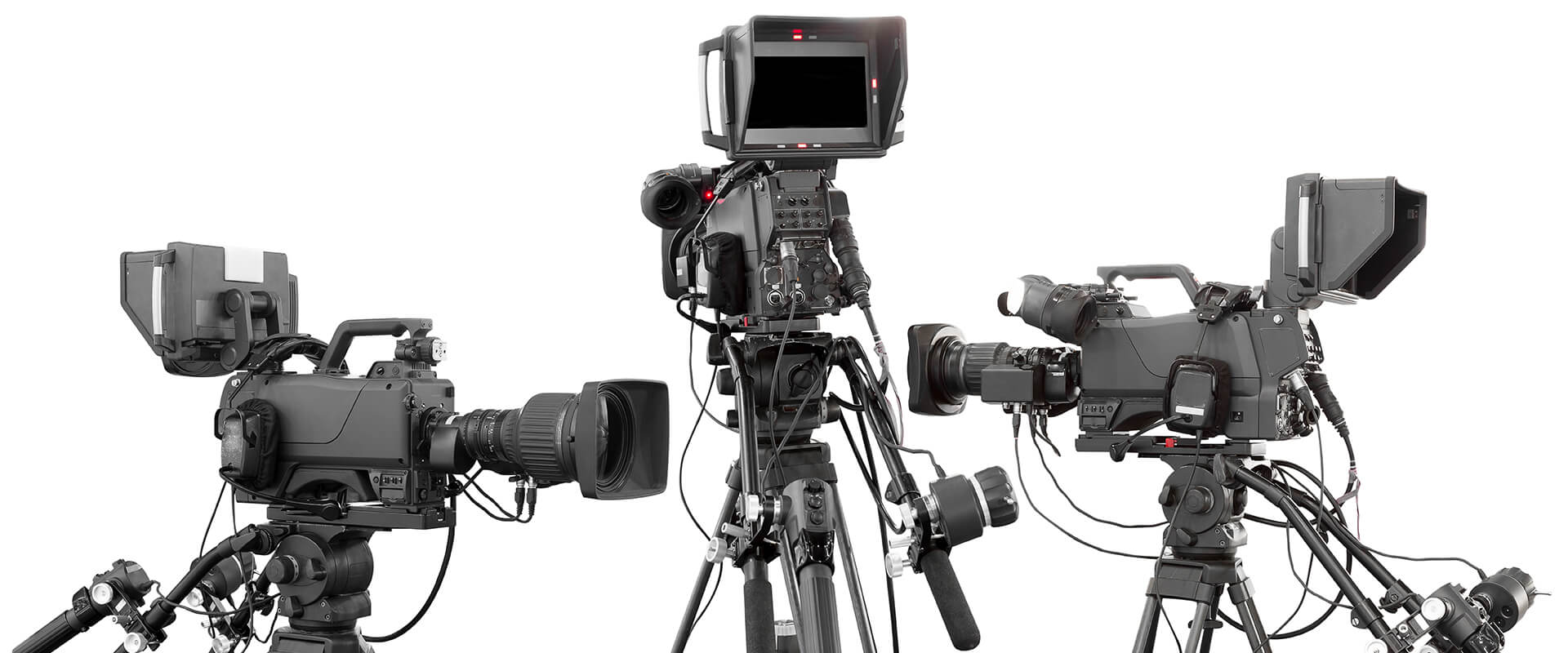 Three broadcast-style cameras on tripods.