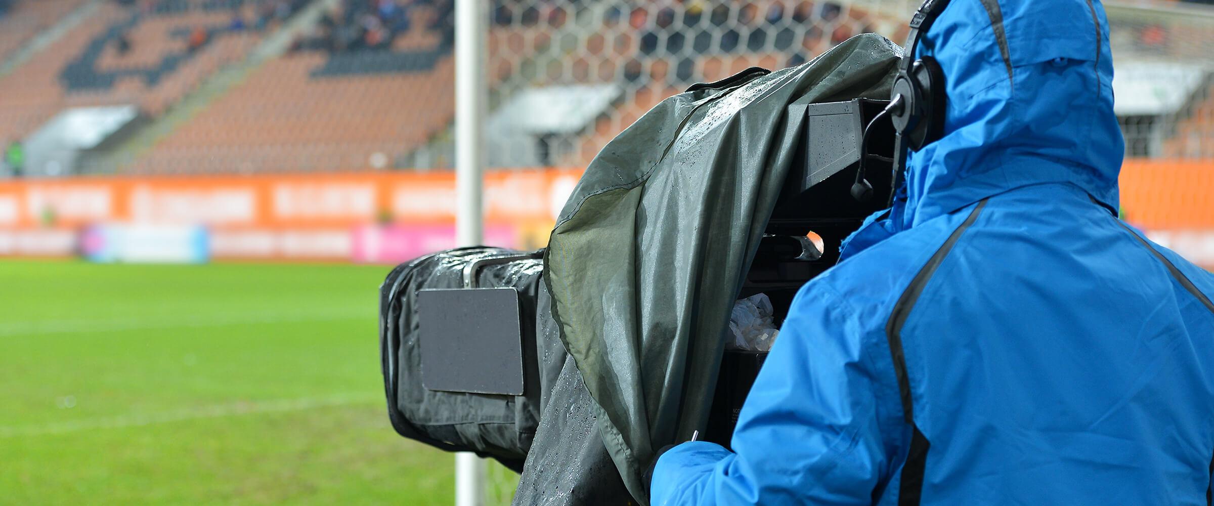 Camera operator in an empty stadium